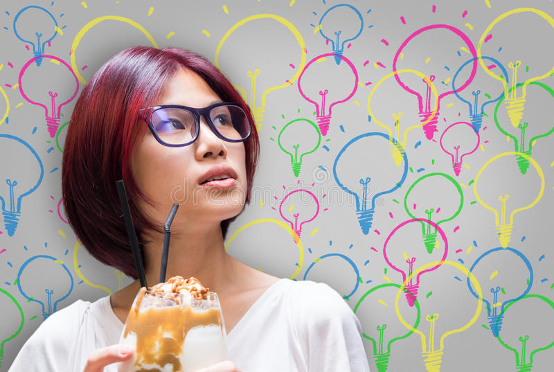 Japanese girl having many ideas bulb royalty free stock image