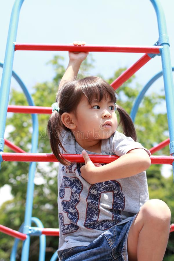 Japanese girl on the jungle gym stock photography