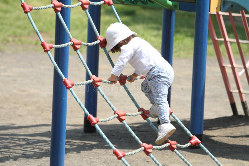 Japanese girl playing with rope walking royalty free stock photos