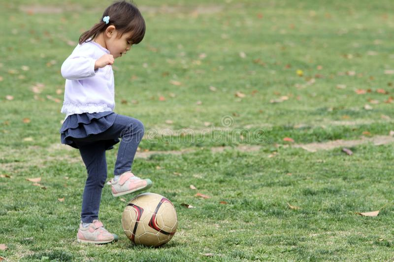 Japanese girl playing with soccer ball stock photo