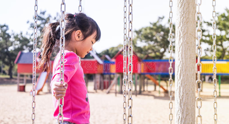 Japanese Girl walking on Obstacle playground royalty free stock image