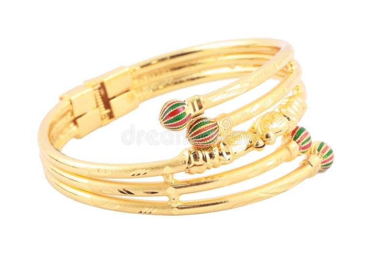 Japanese gold bracelet. Isolated on white background stock photo