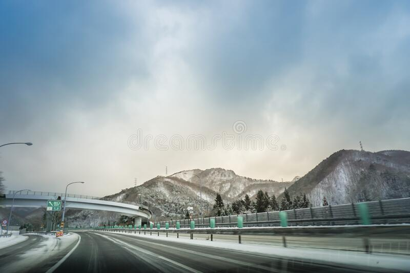 Japanese highway snow mountain in winter royalty free stock images
