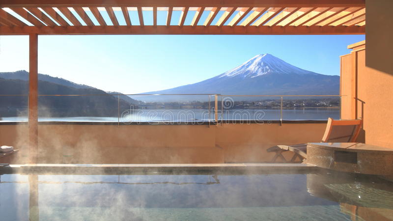 Japanese hot spring with view of the mountain Fuji. Luxurious private japanese open air hot spring called onsen with the beautiful view of mountain Fuji and Lake stock photography