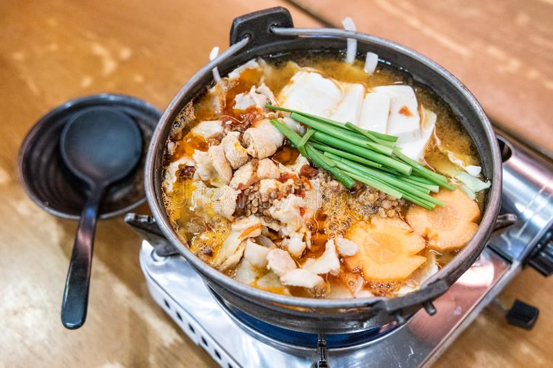 Japanese hotpot buta akakara nabe with pork and spicy soup. In restaurant royalty free stock photography