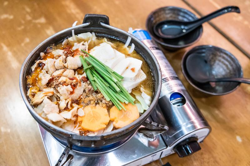 Japanese hotpot buta akakara nabe with pork and spicy soup. In restaurant royalty free stock photos