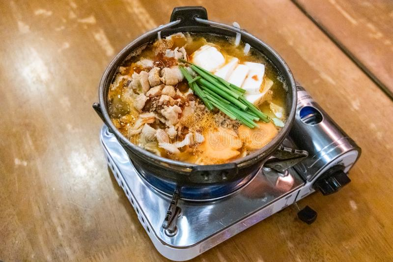 Japanese hotpot buta akakara nabe with pork and spicy soup. In restaurant stock photos