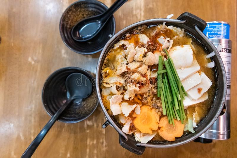 Japanese hotpot buta akakara nabe with pork and spicy soup. In restaurant stock photography