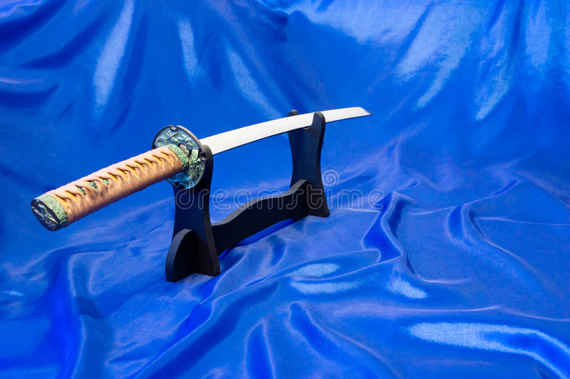 Japanese katana sword. The weapon of a samurai. A formidable weapon in the hands of a master of martial arts.  stock photo