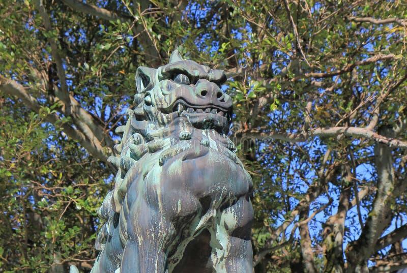 Japanese Komainu lion dog stature. Japanese Komairu stature at Oyama Shrine in Kanazawa Japan.Komainu called lion dogs in English, are statue pairs of lion like stock photos