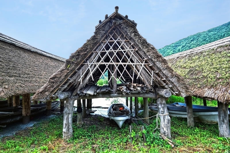 Japanese lake and boat roof of thatch. Japanese Fukui lake and boat roof of thatch stock photos