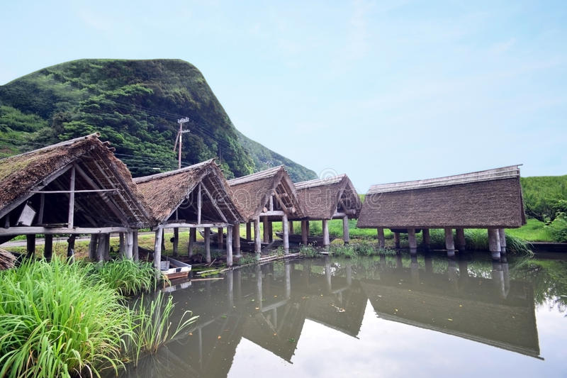 Japanese lake and boat roof of thatch. Japanese Fukui lake and boat roof of thatch stock photo