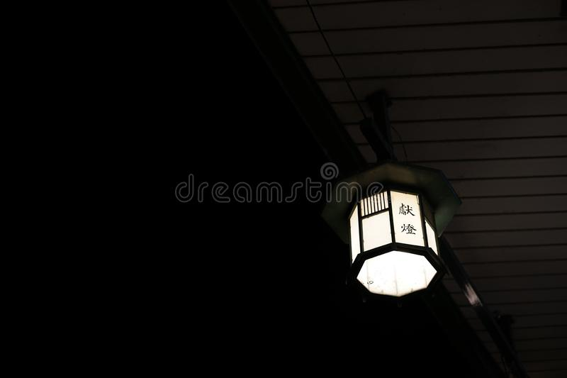 Japanese lantern for autumn festival. A Japanese lantern for autumn festival, with the Japanese-Chinese wording for `lantern for dedication stock photos