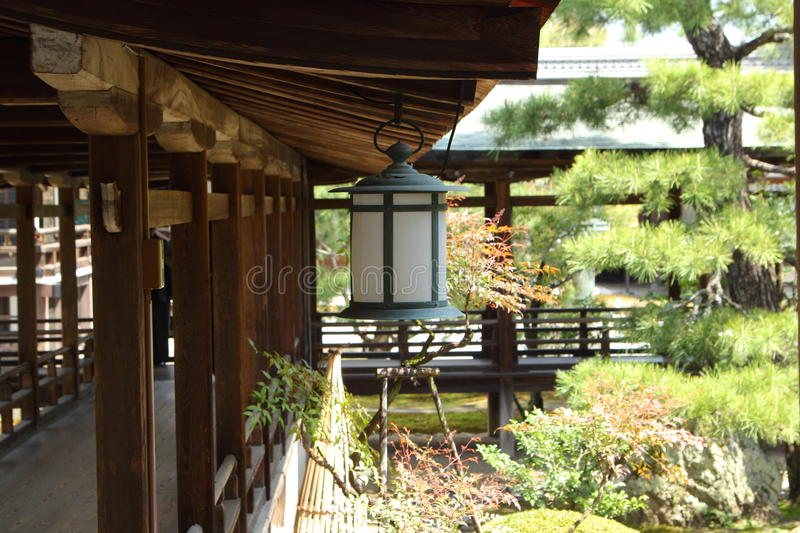Japanese lantern. In beautiful japanese garden in Kyoto royalty free stock photography