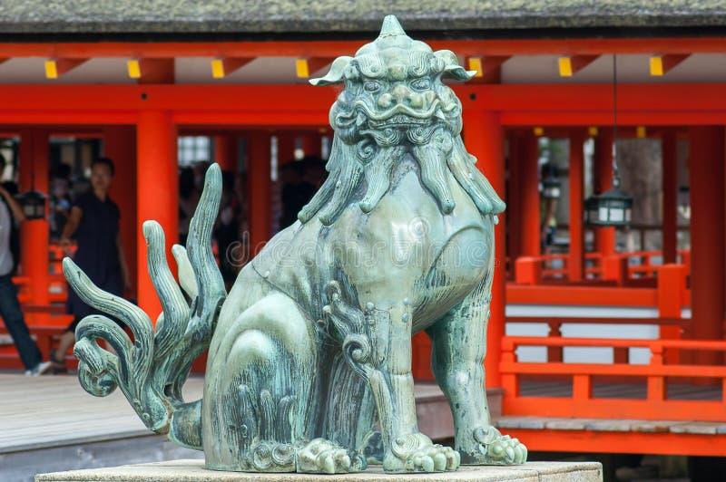 Japanese lion statue. Lion statue guarding the entrance to the Shrine, Miyajima Island, near Hiroshima, Japan royalty free stock photos