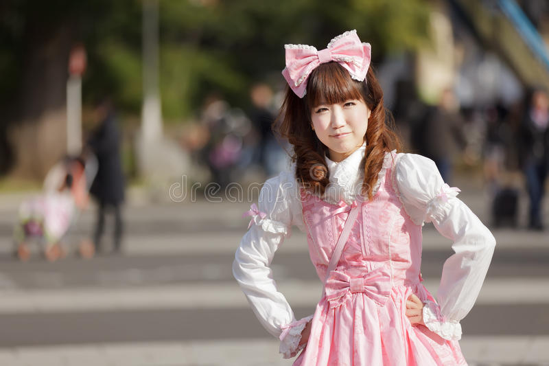 Japanese lolita. Lolita cosplay woman in harajuku park, Tokyo royalty free stock photo