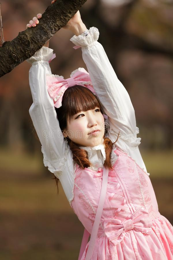 Japanese lolita in nature royalty free stock photos