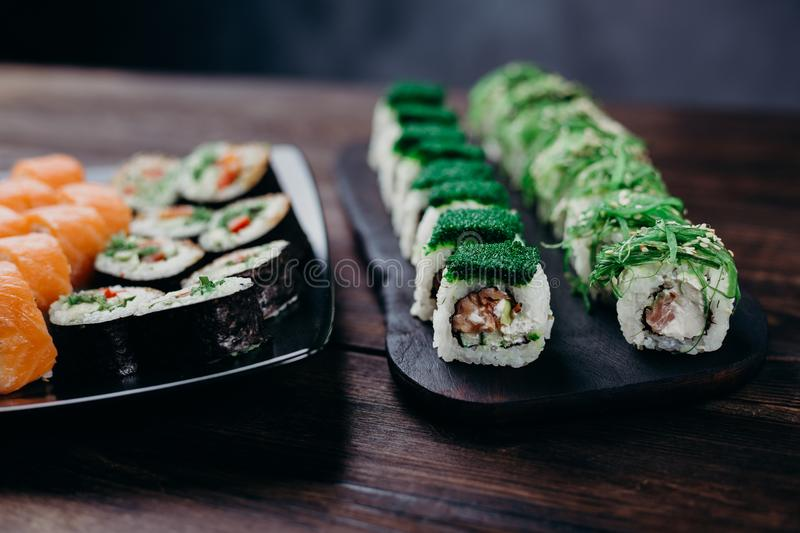 Japanese maki sushi rolls with assorted fillings stock photo