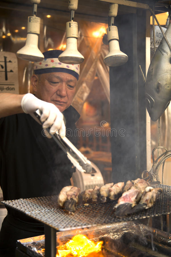 Japanese man cooking on grill royalty free stock photo