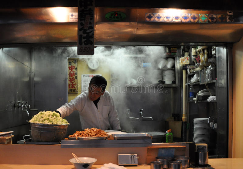 Japanese Man Cooking Ramen On The Street stock images