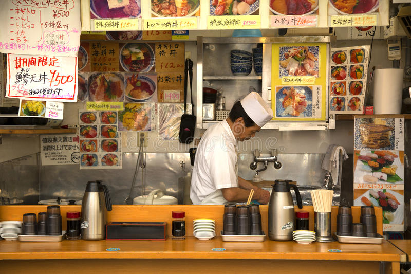 Japanese man in his restaurant stock photography