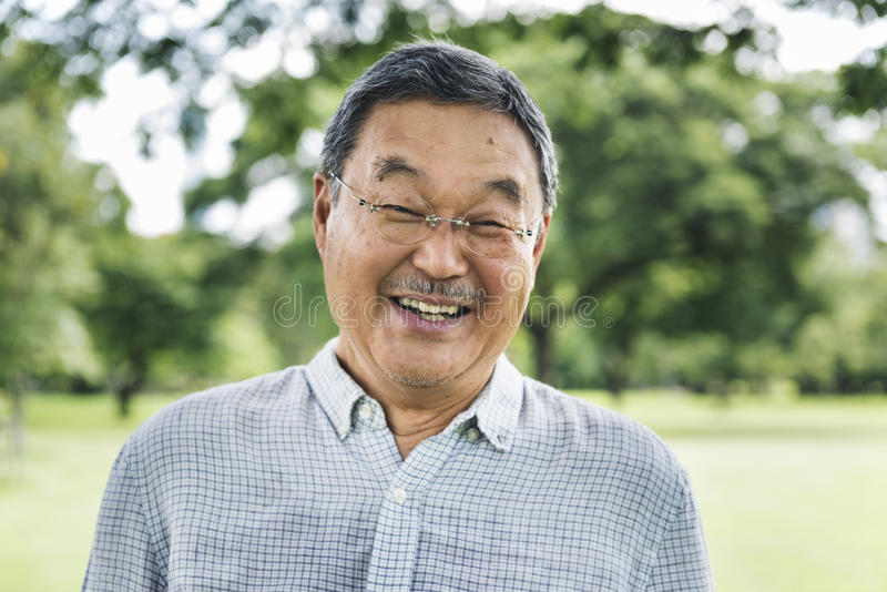 Japanese Man Smiling Lifestyle Happiness Concept stock photos