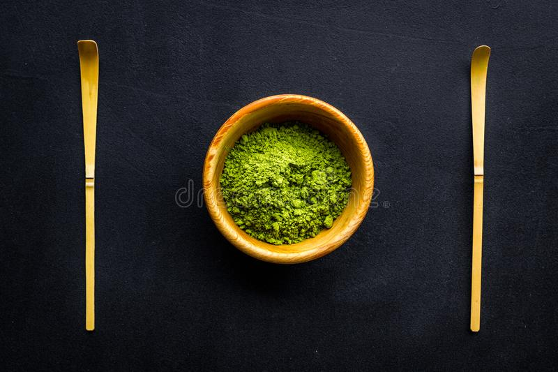 Japanese matcha tea tradition. Matcha accesories near matcha powder in bowl on black background top view stock images