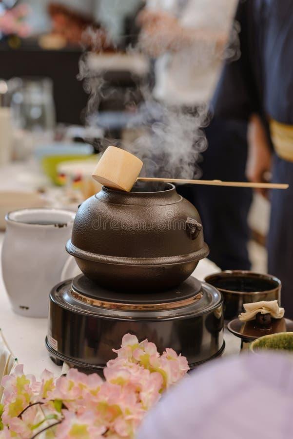 Japanese men preparing green tea during a demonstration Japanese tea ceremony στοκ εικόνες