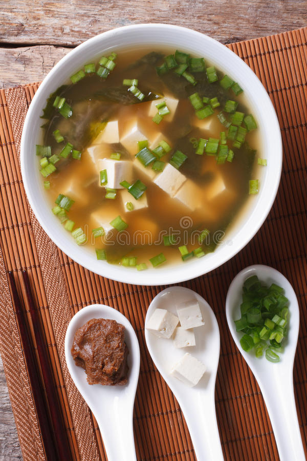 Japanese miso soup and ingredients. top view vertical royalty free stock photography