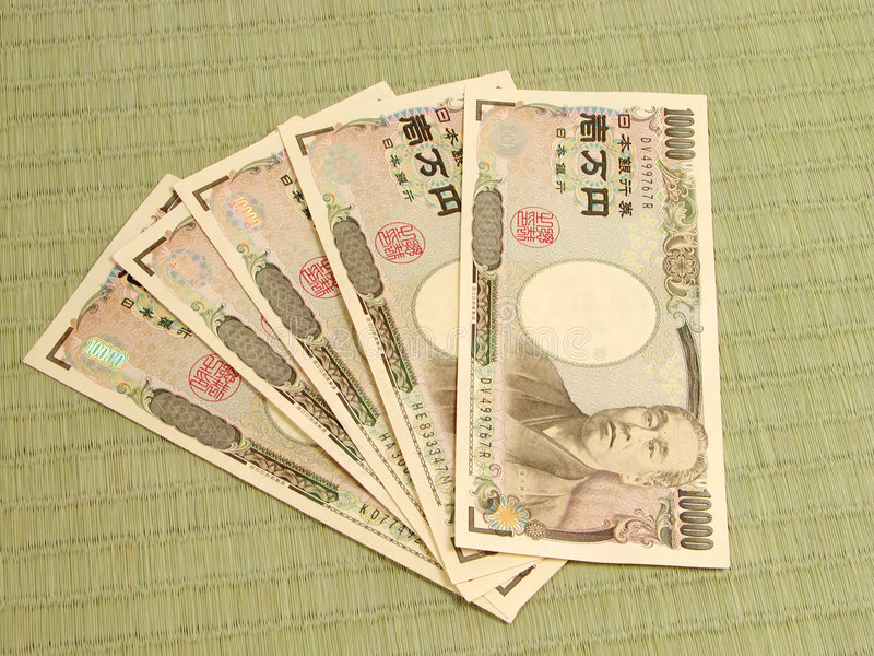 Japanese money on tatami floor royalty free stock image