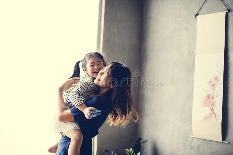 Japanese mother playing with her daughter royalty free stock images