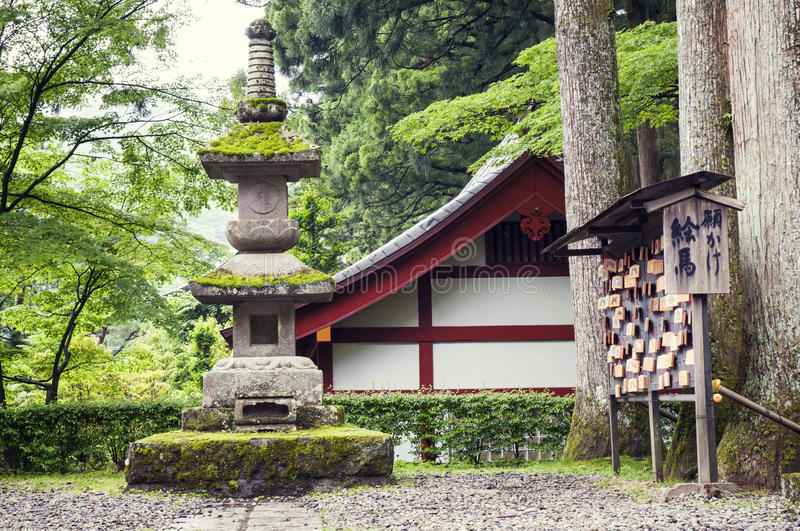 Japanese mountain temple. Ancient stone lantern structure in Japanese temple yard in Nikko, Tochigi prefecture royalty free stock photos