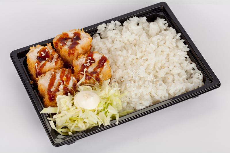 Japanese national popular cuisine. Sushi, rice and fish. Tasty, beautifully served food in a restaurant, cafe. With elements of the original design stock photo