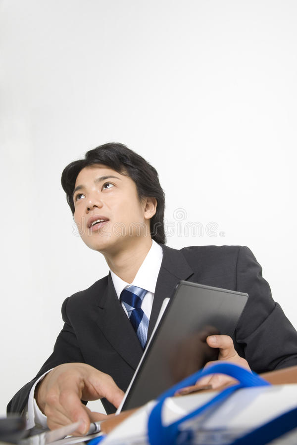 Japanese office worker. BUSINESS IMAGE-a businessman talking about the documents royalty free stock photos