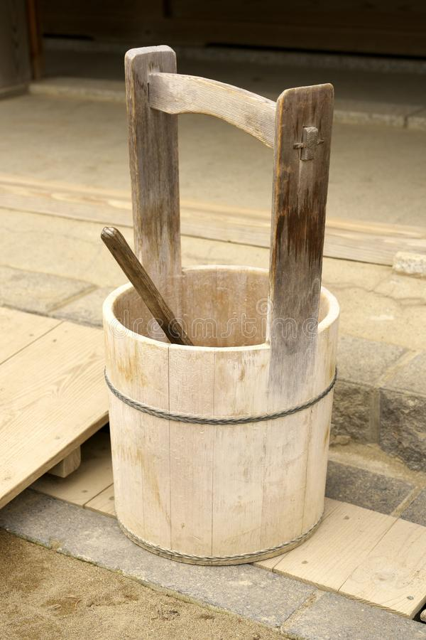 A Japanese pail or a wooden bucket and a ladle or a dipper. Chiba,Japan-February 19, 2019: A Japanese pail or a wooden bucket and a ladle or a dipper royalty free stock images