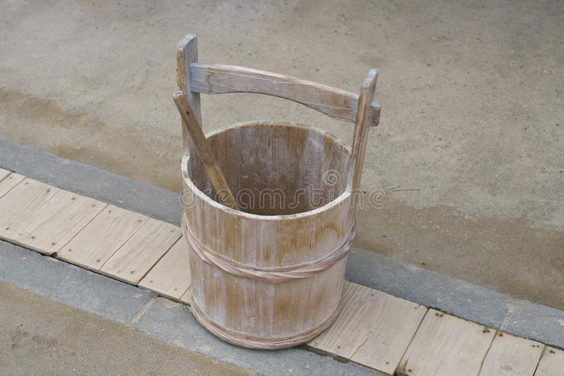 A Japanese pail or a wooden bucket and a ladle or a dipper. Chiba,Japan-February 19, 2019: A Japanese pail or a wooden bucket and a ladle or a dipper royalty free stock photo