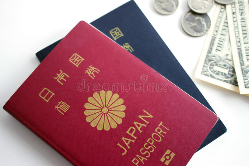 Japanese passport and coins. Japanese passport and dollar bill, quarter,dime, nickel stock images