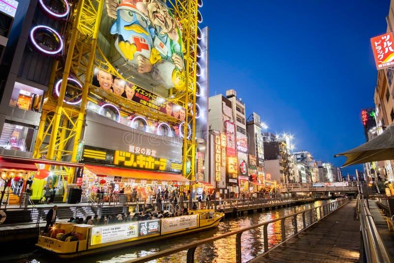 Japanese people and tourists shopping and eating at Dotonbori of Osaka. NAMBA, OSAKA, JAPAN - March 3 2019 : Unidentified japanese people and tourists shopping stock photos