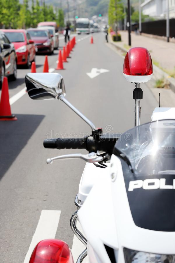 Police motorcycle with red lamp. Japanese police motorcycle with red lamp on the road stock image