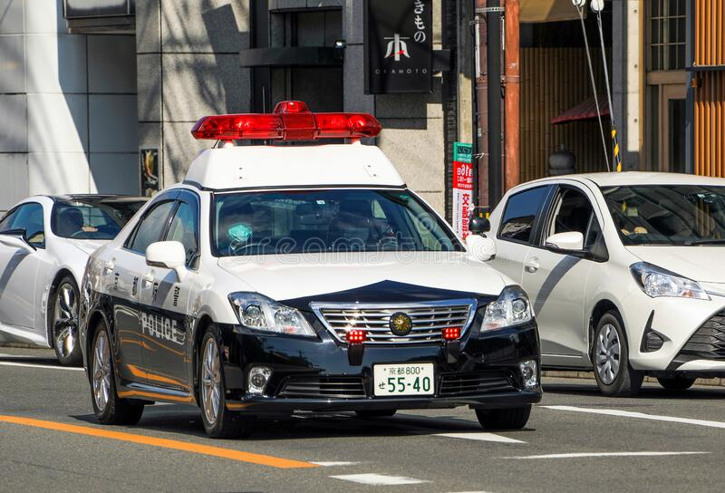 Japanese police patrol car on the street in Kyoto stock photography