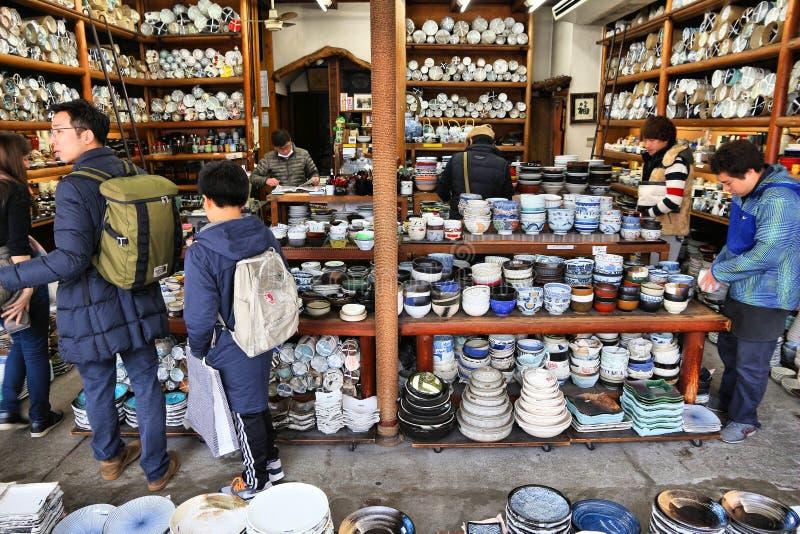 Japanese porcelain. TOKYO, JAPAN - DECEMBER 4, 2016: Japanese ceramic tableware store Kappabashi area of Asakusa in Tokyo, Japan. Kappabashi Street is known for royalty free stock image