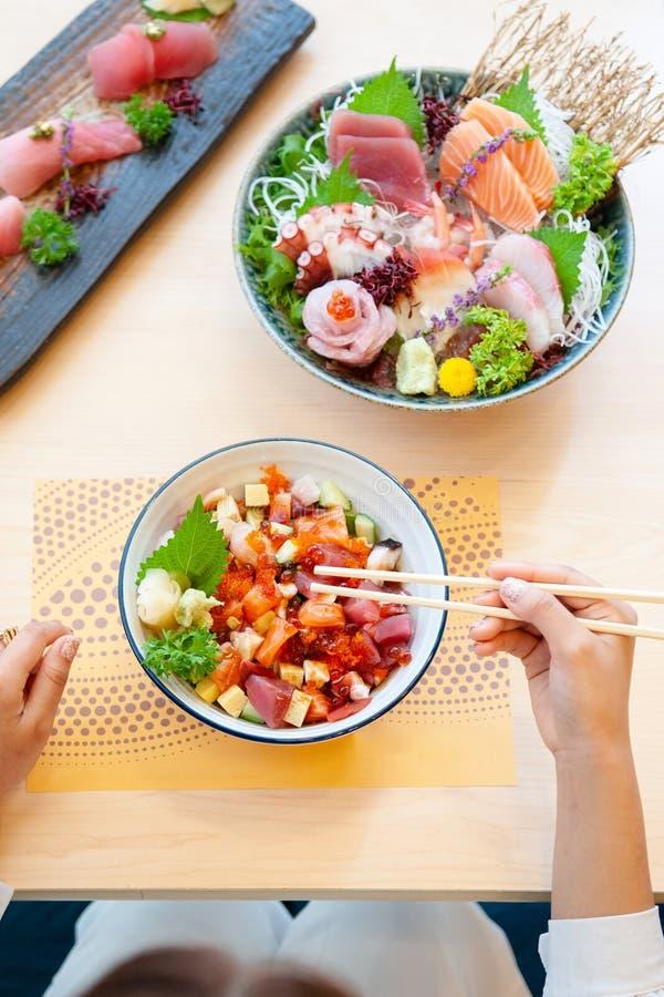 Japanese premium sashimi, Kaisendon sashimi rice bowl. Assorted fresh Japanese sashimi, sushi and Kaisendon premium Japanese sashimi rice bowl on wood table top royalty free stock photos