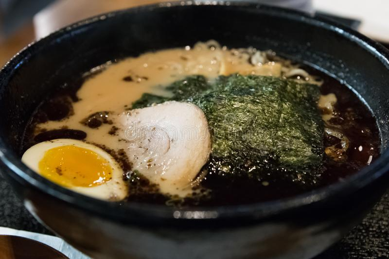 Japanese Ramen in a black bowl stock image