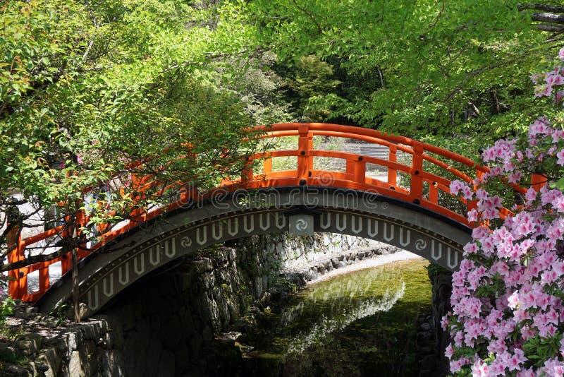 Japanese red wooden bridge in park stock image