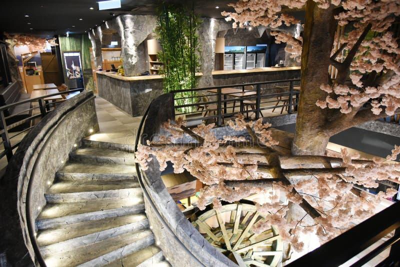 Japanese Restaurant. A Japanese restaurant with sakura tree royalty free stock image
