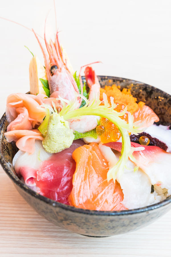 Japanese rice bowl with sashimi seafood on top. Selective focus point stock image