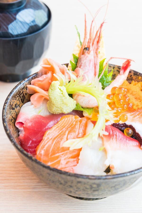Japanese rice bowl with sashimi seafood on top. Selective focus point stock photo