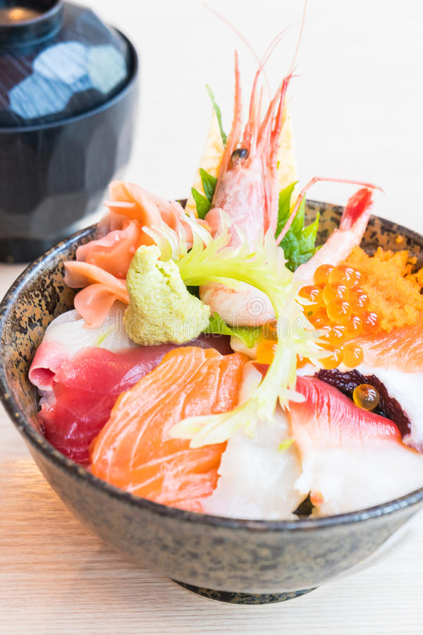 Japanese rice bowl with sashimi seafood on top. Selective focus point stock photos