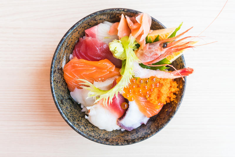 Japanese rice bowl with sashimi seafood on top. Selective focus point royalty free stock photo