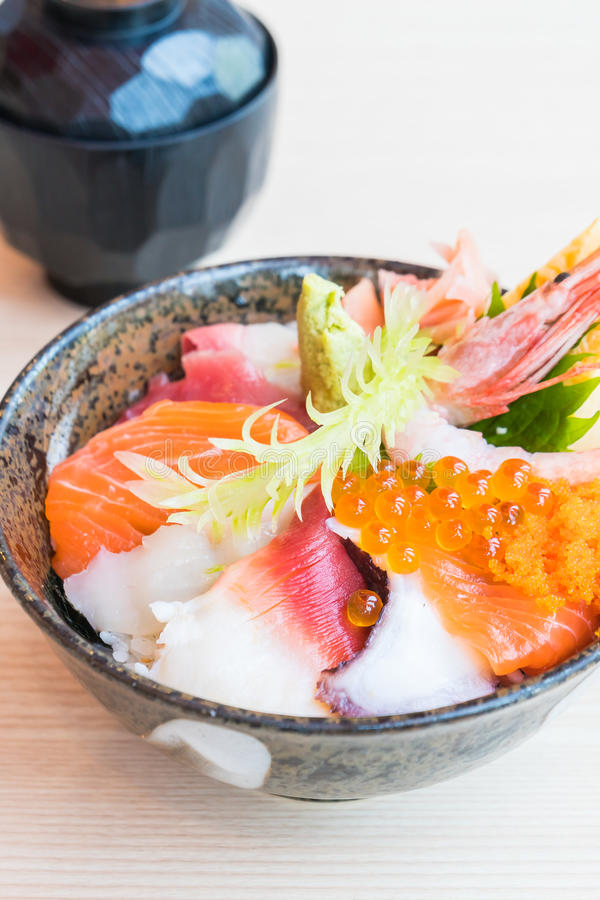 Japanese rice bowl with sashimi seafood on top. Selective focus point royalty free stock images